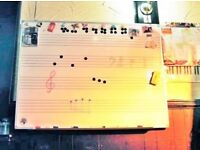 MUSIC STAVE MAGNETIC WHITEBOARD. 120 BY 90 CM. WITH MAGNETIC BOARD WIPERS AND MAGNETIC NOTE HEADS.