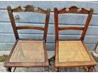 A pair of Edwardian walnut framed bedroom chairs with rattan seat panels