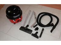 HENRY HOOVER WITH SEALED TOOLS AND SMALL ATTACHMENTS