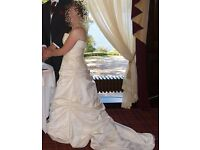 Stunning wedding dress by Joyce in cream / ivory. Size 14 suitable for 5ft 1 and under.