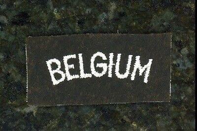 """WWII British Tab """"Belgium""""."""