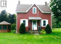 3 Acre propery with House, Garage, and Barn.  Available Now