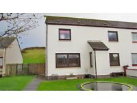Spacious three-bedroom end terrace house in Portmahomack Tain with a specious garden