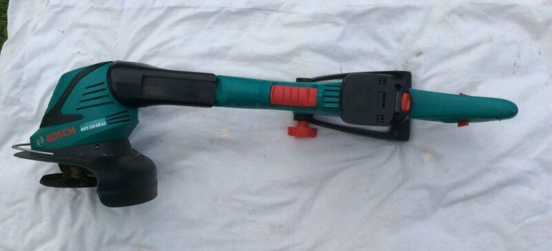 BOSCH 18 VOLT CORDLESS TRIMMER (LITHIUM ION BATTERY ) FOR SALE
