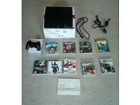 Playstation 3 very good condition perfect working order complete with 9 GAMES and instructions