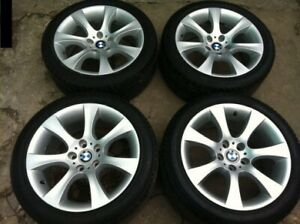 "Set of 4, 18"" BMW style 124 rims on Rubber"