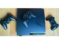 PS3 console with 3 remotes and 20 games