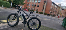 Electric mountain fat wheel bike up for grabs. mid drive motor