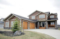 Available immediately - gorgeous home on Cochrane lakes