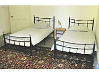 Two Victorian style metal Single Beds with mattresses