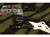 Xbox 360 with games and guitars for guitar hero