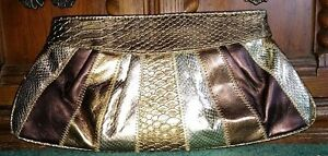 Shiny gold tone faux leather patch work purse