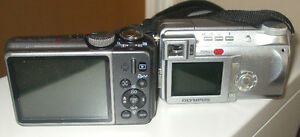 2 Digital cameras Canon+Olympus
