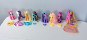 8 My Little Pony figurines, each with an accessory