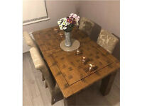 Solid oak dining table with 4 chairs (Oak furniture land)