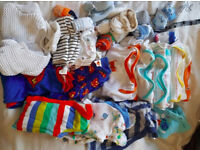 bundle of baby boy clothes, newborn size