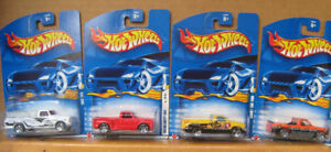 HotWheels ,  4 Trucks , chevy ,  Ford ... . New and in Original