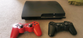 Sony ps3 with 2 controllers and 11 games