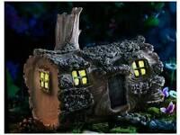 Solar fairy log house