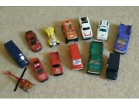 Set of toy vans and cars and helicopter