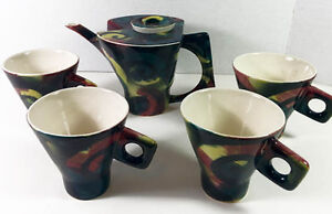 Collector Hand Painted Tea/Coffee Ceramic set by Guy Simoneau,