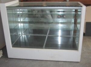 A glass display cabinet and mirror for sale