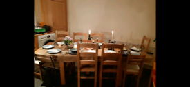 Solid oak extendable dining table with 6 matching chairs