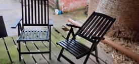 Two wooden recliner garden chairs