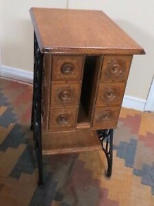 Table re-purposed from Singer treadle sewing machine table