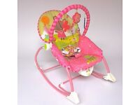 A high quality rocker chair BARELY USED designed for use from birth up to 40lbs. LIKE NEW!!!!