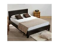 Double, brown, leather bed, frame, with, thick, mattress.