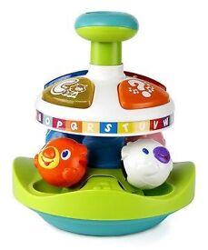 Bright starts alphabet pop top toy