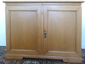 Antique light oak cupboard with lock and original key and 2 pull out shelves.