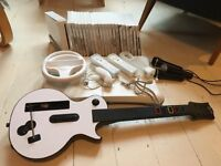 Nintendo Wii Console, Wii Fit Board, Guitar Hero and Various Accessories