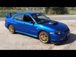 Looking for a Subaru wrx sti 15000$
