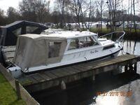 Foster 21 Sports Cabin Cruiser **moored at Stalham, Norfolk Broads**