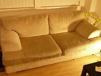 White three seater sofa
