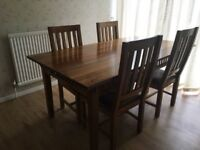 Wooden dining room table and 6 chairs