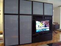 "8f long wall unit. Holds up to 44"" TV.  Brown/Black Opaque Doors"
