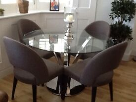 Beautiful round glass dining table and chairs