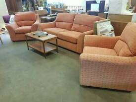 Red patterned fabric two seater sofa with 2 armchairs
