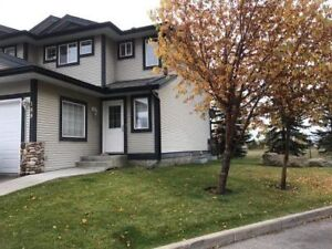 Chestermere Condo close to schools and shopping