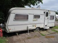 Caravan in need of tender loving care and upcycle
