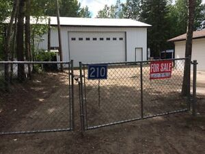 Lake Front lot with cabin and 40x56 heated shop.