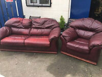 Red Leather large two seater sofa and single armchair.delivery possible