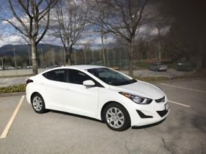2015 Hyundai Elantra with a set of Winter and Summer Tires