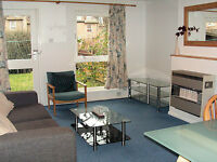 Central 1 bed property with Private Garden