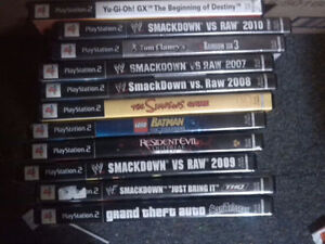 Various PS2, PS3, and other gaming items.