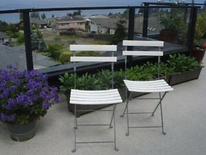 Pair of folding metal chairs