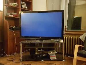 LG SMART TV with a tv stand